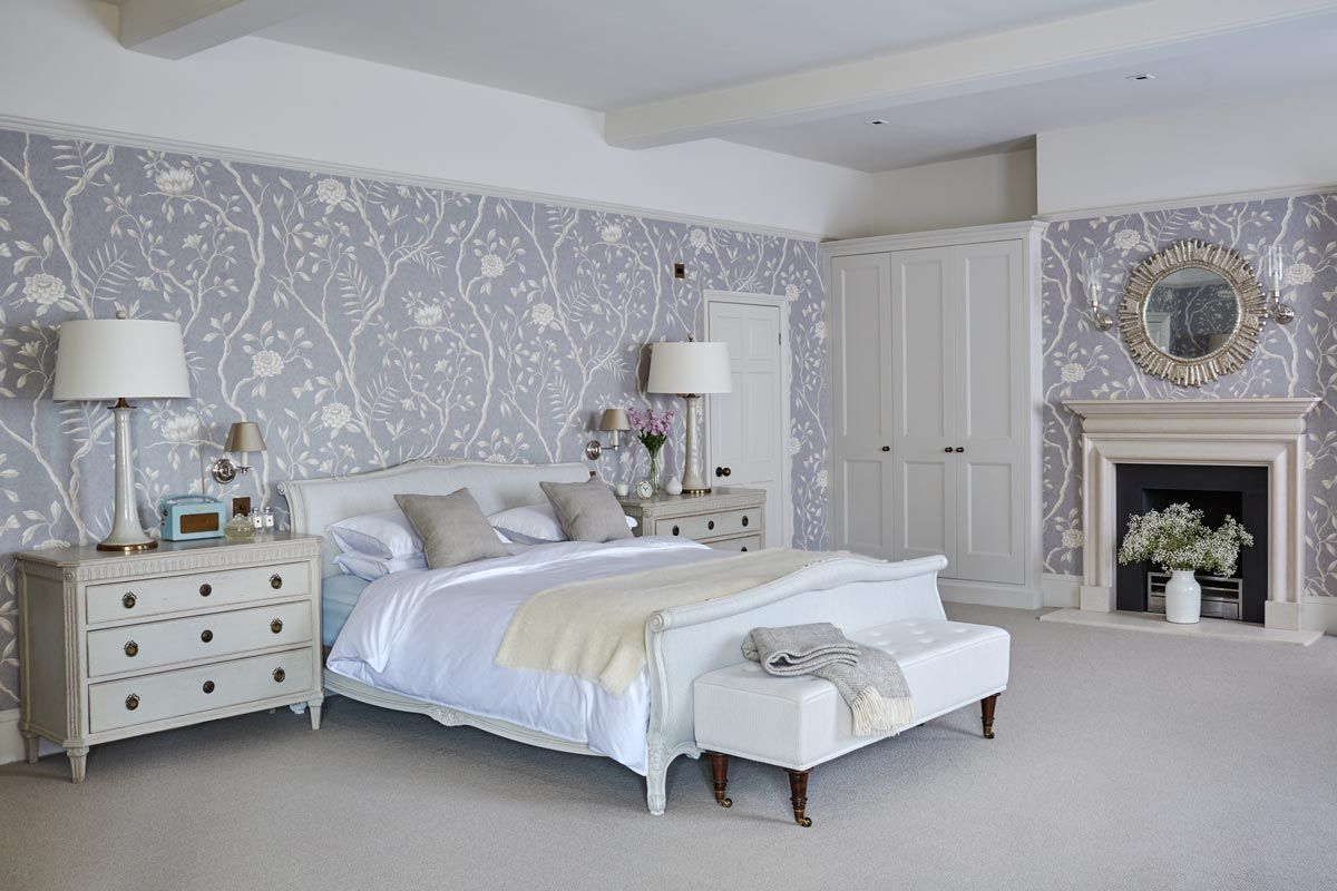 a beautiful white bed room